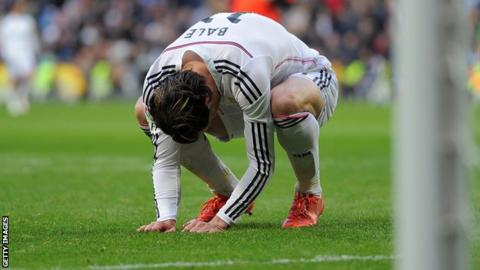 Gareth Bale bows his head after missing an easy opportunity