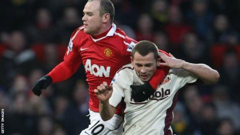 Manchester United's Wayne Rooney & Phil Bardsley