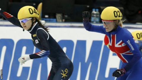 Elise Christie (right) celebrates silver in the 1000m