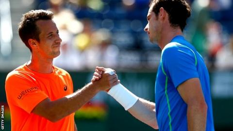 Andy Murray of Great Britain is congratulated by Philipp Kohlschreiber of Germany
