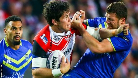 Louie McCarthy-Scarsbrook is tackled by Warrington's Simon Grix