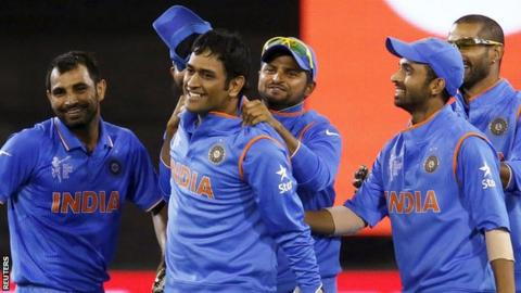 MS Dhoni (second from left) and Indian players celebrate during the quarter-final with Bangladesh