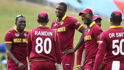 Jason Holder (centre) celebrates a wicket with team-mates