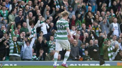 Gary Mackay-Steven holds back his celebration after scoring against his old club