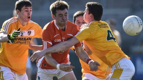 Armagh's Calum McComiskey comes up against Antrim duo Conor O'Rawe and Gerard McCorley