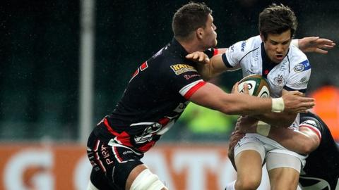 Darren Barry tackles Bristol's Adam D'Arcy