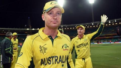 Australian captain Michael Clarke (L) and wicketkeeper Brad Haddin leave the field after defeating India