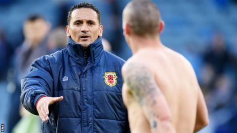 Gibraltar interim head coach David Wilson congratulates Scotland captain Scott Brown