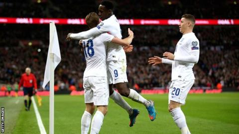 Kane celebrates his debut England goal with Danny Welbeck and Ross Barkley