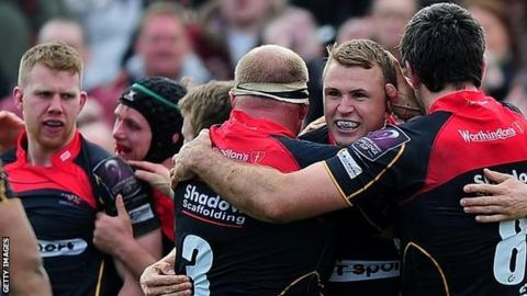 Dragons celebrate their win over Blues