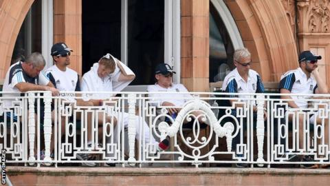 England players and management on the balcony