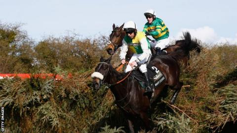 AP McCoy aboard Shutthefrontdoor pursues eventual winner Many Clouds