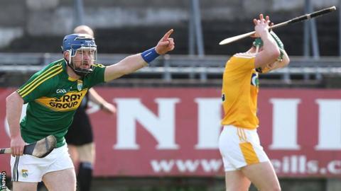 John Egan celebrates after hitting Kerry's winning point as Antrim's Odhran McFadden shows his dejection