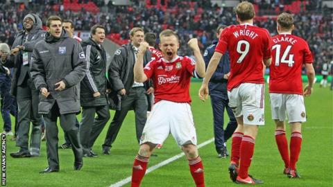 Dean Keates celebrates after leading Wrexham to victory in the FA Trophy final this season