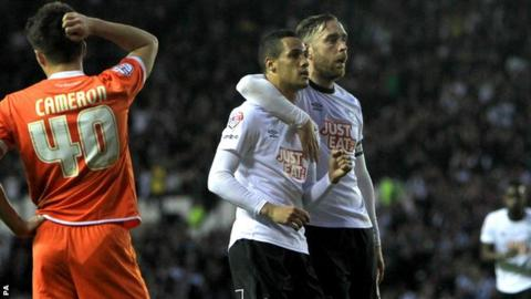 Tom Ince celebrates scoring with Richard Keogh