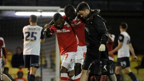 Ismail Yakubu is helped off the field in the 2-0 defeat against Southend United at Roots Hall