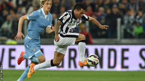 Juventus forward Carlos Tevez in action against Lazio