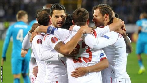 Sevilla players celebrate scoring against Zenit St Petersburg