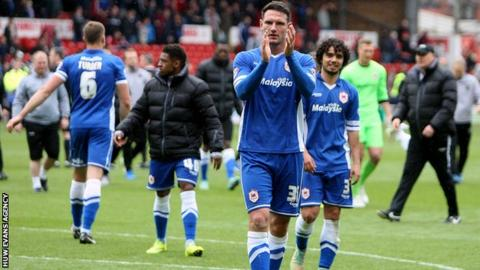 Cardiff defender Sean Morrison applauds the travelling fans after the win at Forest