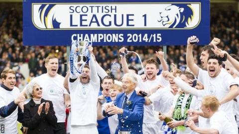 Greenock Morton players celebrate with the Scottish League One trophy