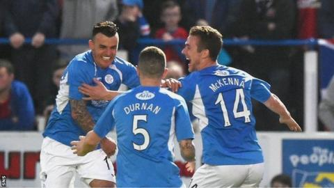 Derek Lyle (left) celebrates having opened the scoring for Queens against Rangers