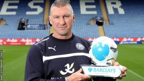 Leicester boss Nigel Pearson with his manager of the month trophy