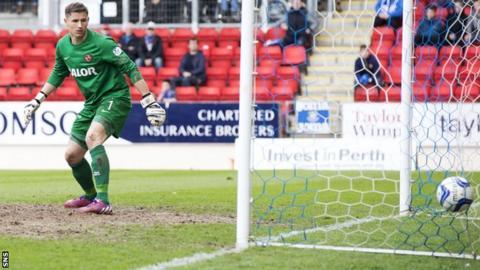 Dundee United goalkeeper Radoslaw Cierzniak watches Murray Davidson's strike hit the net