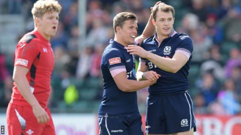 Scotland duo Nyle Godsmark (right) and Gavin Lowe celebrate victory over Wales