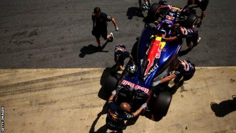 Daniel Ricciardo's Red Bull is inspected by the Red Bull engineers