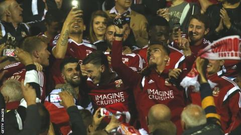 Swindon Town players celebrate