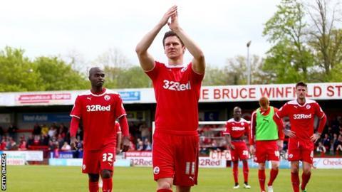 Crawley Town midfielder Josh Simpson applauds fans