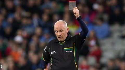 Sligo referee Marty Duffy waves a black card during this year's Football League