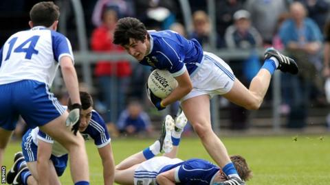 Cavan's Patrick O'Reilly attempts to keep his balance at Breffni Park