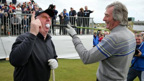 Former snooker world champion Dennis Taylor appears to have snookered the tee shot of Pat Jennings tee shot