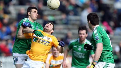 Fermanagh's Mickey Jones challenges Antrim opponent Conor Murray in the Ulster SFC game at Brewster Park