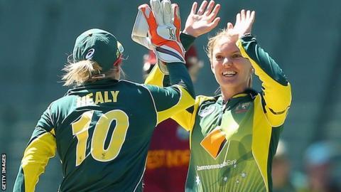 Kristen Beams (right) celebrates a wicket