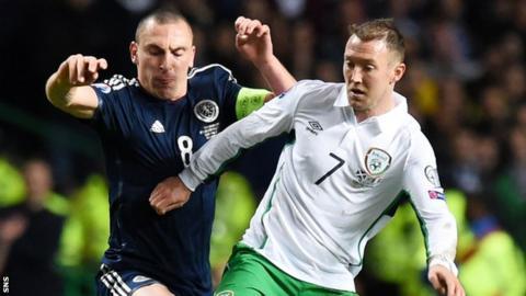 Scotland captain Scott Brown challenges Aiden McGeady