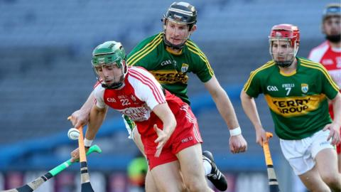 Niall Ferris of Derry comes under pressure from Kerry's Bryan Murphy during the Christy Ring Cup final