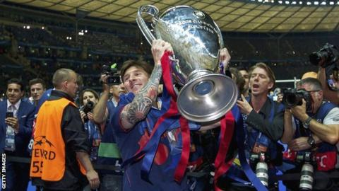 Barcelona's Lionel Messi lifts the Champions League trophy in Berlin