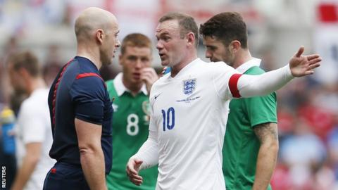 England striker Wayne Rooney speaks to the referee during the match against the Republic of Ireland