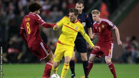 Wales midfielder Aaron Ramsey tussles with Belgium's Marouane Fellaini during the 0-0 draw in November 2014