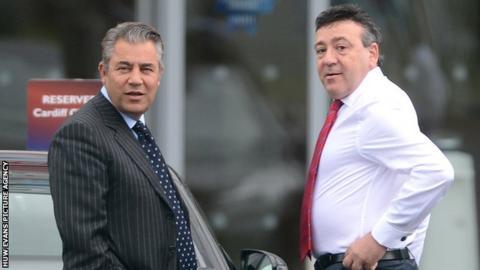 Cardiff City chairman Mehmet Dalman (L) with Michael Filiou
