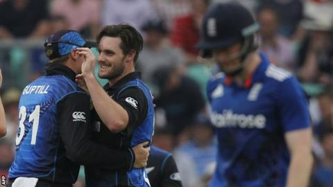 Mitchell McClenaghan (centre) celebrates taking the wicket of England's Captain Eoin Morgan