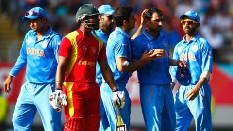 India celebrate the dismissal of Zimbabwe's Sikandar Raza