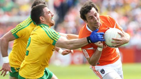 Donegal's Paddy McGrath challenges Armagh dangerman Jamie Clarke during the Championship game at the Athletic Grounds