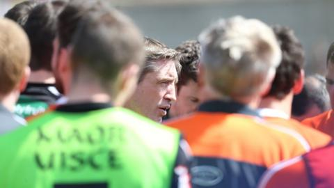 Armagh manager Kieran McGeeney talks to his defeat Armagh players after the Championship match against Donegal