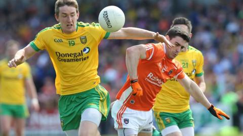 Hugh McFadden of Donegal in action against Armagh's Caolan Rafferty