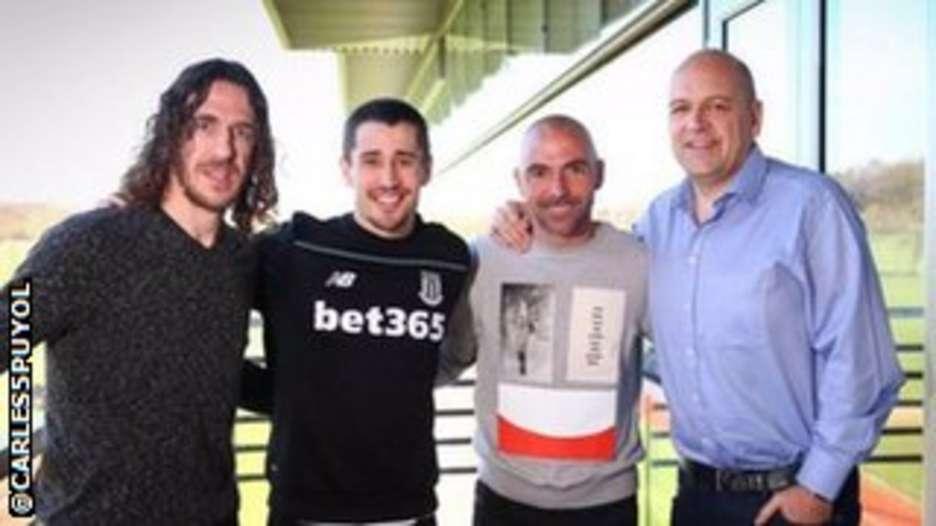 Carlos Puyol (left) with Bojan Krkic