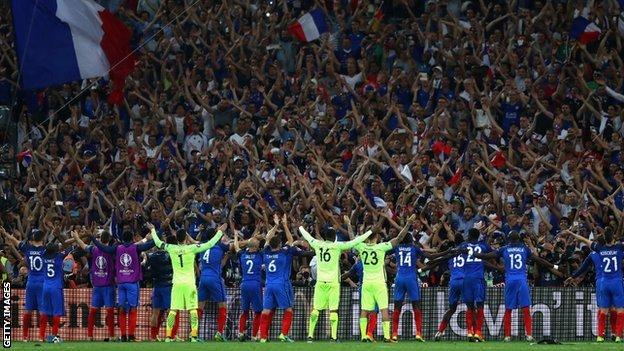 France's players celebrate their semi-final win with their fans