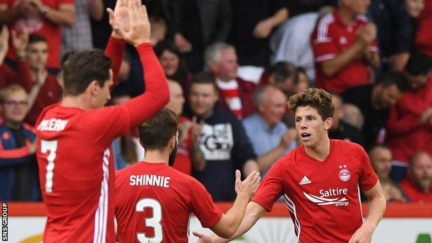 Ryan Christie (right) opened the scoring at Pittodrie with a fine strike